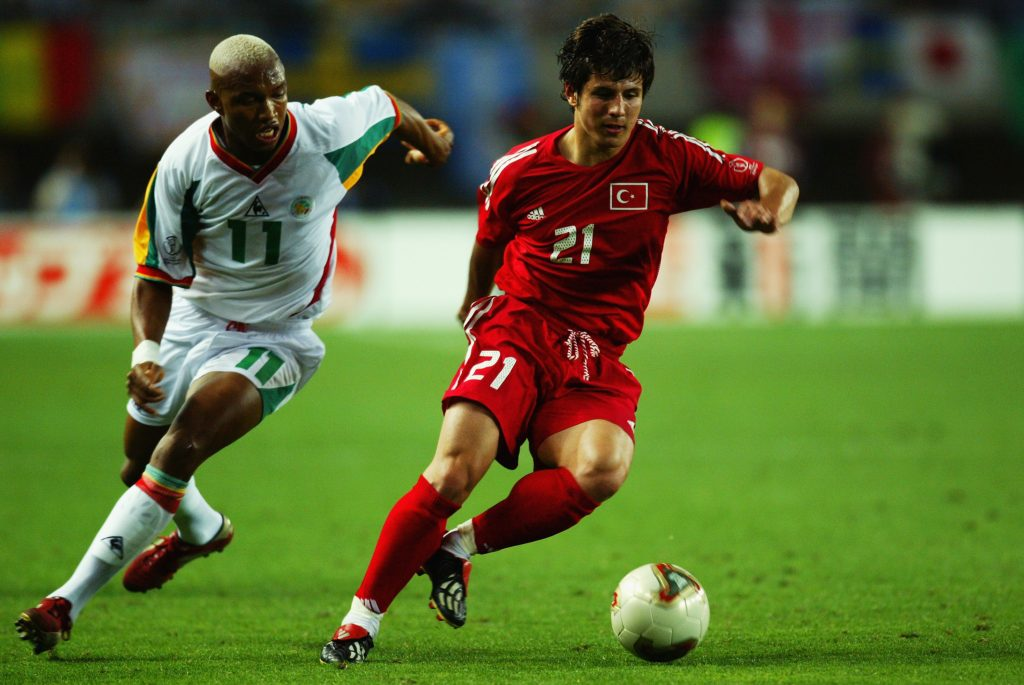 Emre Belozoglu of Turkey takes the ball past El Hadji Diouf of Senegal during the 2002 FIFA World Cup.