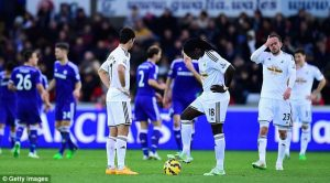 Swansea players look dejected during the 5-0 loss to Chelsea