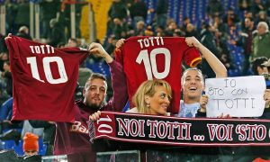 Roma fans show their support for Francesco Totti during the Serie A match against Palermo