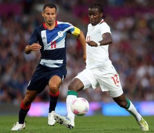 Team GB football captain and Manchester United legend Ryan Giggs competes for the ball with Ibrahima Balde of Senegal at the London 2012 Olympics
