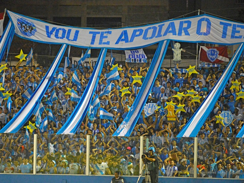The loyal fans of Paysandu Sport Club cheer their team on, with some brandishing stars that have written on them the various years that the club has won the state-wide