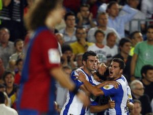 Espanyol's Raul Tamudo celebrates with teammates after scoring against Barcelona