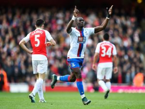 Yannick Bolasie celebrates his late equaliser against Arsenal in Game 4