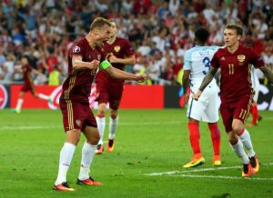 Berezutski celebrates his last-gasp equaliser against England