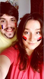 Jed and I paint our faces in our adopted nations colours
