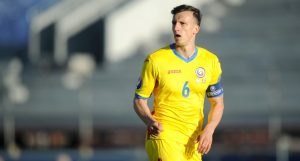 Vlad Chiriches (above) will partner Grigore at the heart of the Tricolorii defence