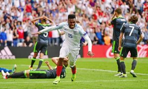 Sturridge wheels away in celebration as he grabs a late winner for England