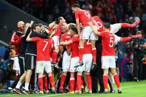 The Welsh players celebrate Ashley Williams' headed equaliser