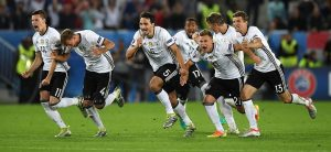 A familiar sight. Germany burst with joy after the shootout success over Italy.