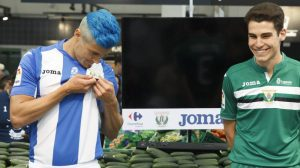 CD Leganés launch this season's kit in front of a stall of cucumbers
