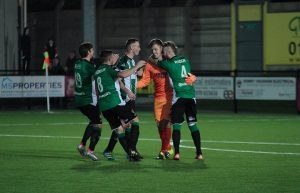 Chris Mullock's teammates celebrate his unlikely first goal on the artificial surface at Park Avenue